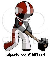 Black Football Player Man Hitting With Sledgehammer Or Smashing Something At Angle