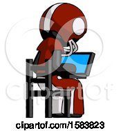 Black Football Player Man Using Laptop Computer While Sitting In Chair View From Back