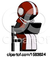 Black Football Player Man Using Laptop Computer While Sitting In Chair Angled Right