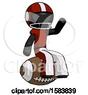 Black Football Player Man Sitting On Giant Football