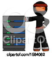 Orange Ninja Warrior Man With Server Rack Leaning Confidently Against It