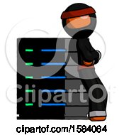 Orange Ninja Warrior Man Resting Against Server Rack Viewed At Angle