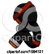 Orange Ninja Warrior Man Sitting With Head Down Facing Sideways Left