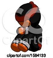 Orange Ninja Warrior Man Sitting With Head Down Facing Angle Left