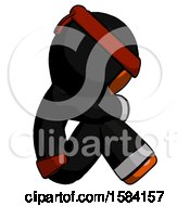 Orange Ninja Warrior Man Sitting With Head Down Facing Sideways Right