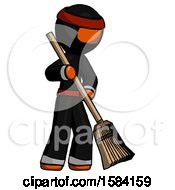Orange Ninja Warrior Man Sweeping Area With Broom