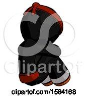 Orange Ninja Warrior Man Sitting With Head Down Back View Facing Right