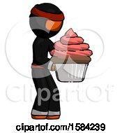Orange Ninja Warrior Man Holding Large Cupcake Ready To Eat Or Serve