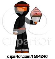 Orange Ninja Warrior Man Presenting Pink Cupcake To Viewer