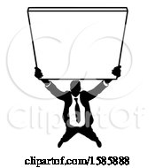 Silhouetted Business Man Holding Up A Sign