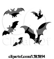 Clipart Of Silhouetted Vampire Bats Royalty Free Vector Illustration by AtStockIllustration