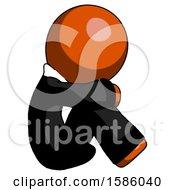 Orange Clergy Man Sitting With Head Down Facing Sideways Right