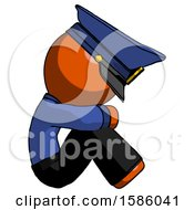 Orange Police Man Sitting With Head Down Facing Sideways Right