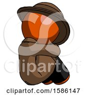 Orange Detective Man Sitting With Head Down Back View Facing Right