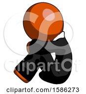 Orange Clergy Man Sitting With Head Down Facing Sideways Left