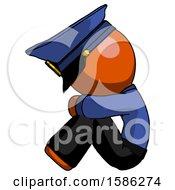 Orange Police Man Sitting With Head Down Facing Sideways Left