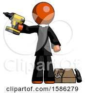 Orange Clergy Man Holding Drill Ready To Work Toolchest And Tools To Right