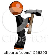 Orange Clergy Man Hammering Something On The Right