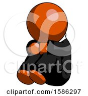 Orange Clergy Man Sitting With Head Down Facing Angle Left