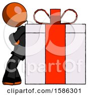 Orange Clergy Man Gift Concept Leaning Against Large Present