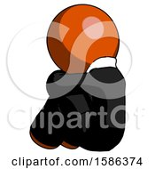 Orange Clergy Man Sitting With Head Down Back View Facing Left