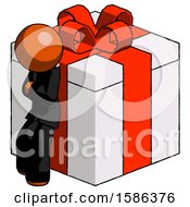 Orange Clergy Man Leaning On Gift With Red Bow Angle View