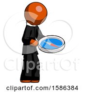 Orange Clergy Man Looking At Large Compass Facing Right