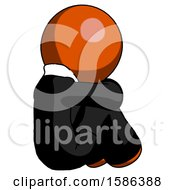 Orange Clergy Man Sitting With Head Down Back View Facing Right