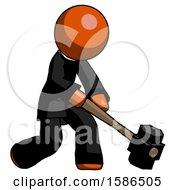 Orange Clergy Man Hitting With Sledgehammer Or Smashing Something At Angle