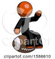 Orange Clergy Man Sitting On Giant Football