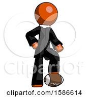 Orange Clergy Man Standing With Foot On Football