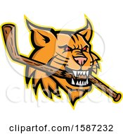 Red Eyed Bobcat Mascot Head Biting A Wooden Hockey Stick