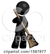 Black Clergy Man Sweeping Area With Broom