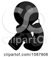 Black Clergy Man Sitting With Head Down Facing Sideways Left