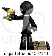 Black Clergy Man Holding Drill Ready To Work Toolchest And Tools To Right