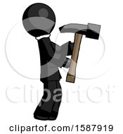 Black Clergy Man Hammering Something On The Right