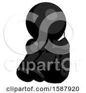 Black Clergy Man Sitting With Head Down Facing Angle Left
