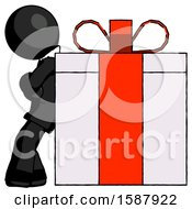 Black Clergy Man Gift Concept Leaning Against Large Present
