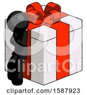 Black Clergy Man Leaning On Gift With Red Bow Angle View