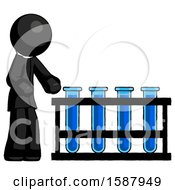 Black Clergy Man Using Test Tubes Or Vials On Rack
