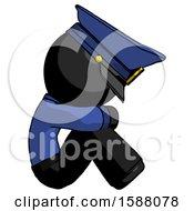 Black Police Man Sitting With Head Down Facing Sideways Right
