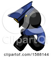 Black Police Man Sitting With Head Down Facing Sideways Left