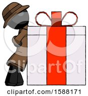 Black Detective Man Gift Concept Leaning Against Large Present