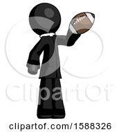 Black Clergy Man Holding Football Up