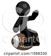 Black Clergy Man Sitting On Giant Football