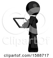 Black Clergy Man Looking At Tablet Device Computer With Back To Viewer