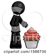 Black Clergy Man With Giant Cupcake Dessert