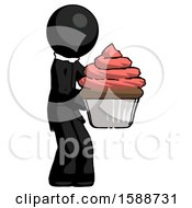 Black Clergy Man Holding Large Cupcake Ready To Eat Or Serve