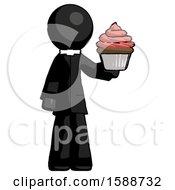 Black Clergy Man Presenting Pink Cupcake To Viewer