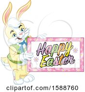 Clipart Of A Yellow Bunny Rabbit Holding A Happy Easter Sign Royalty Free Vector Illustration by Lawrence Christmas Illustration